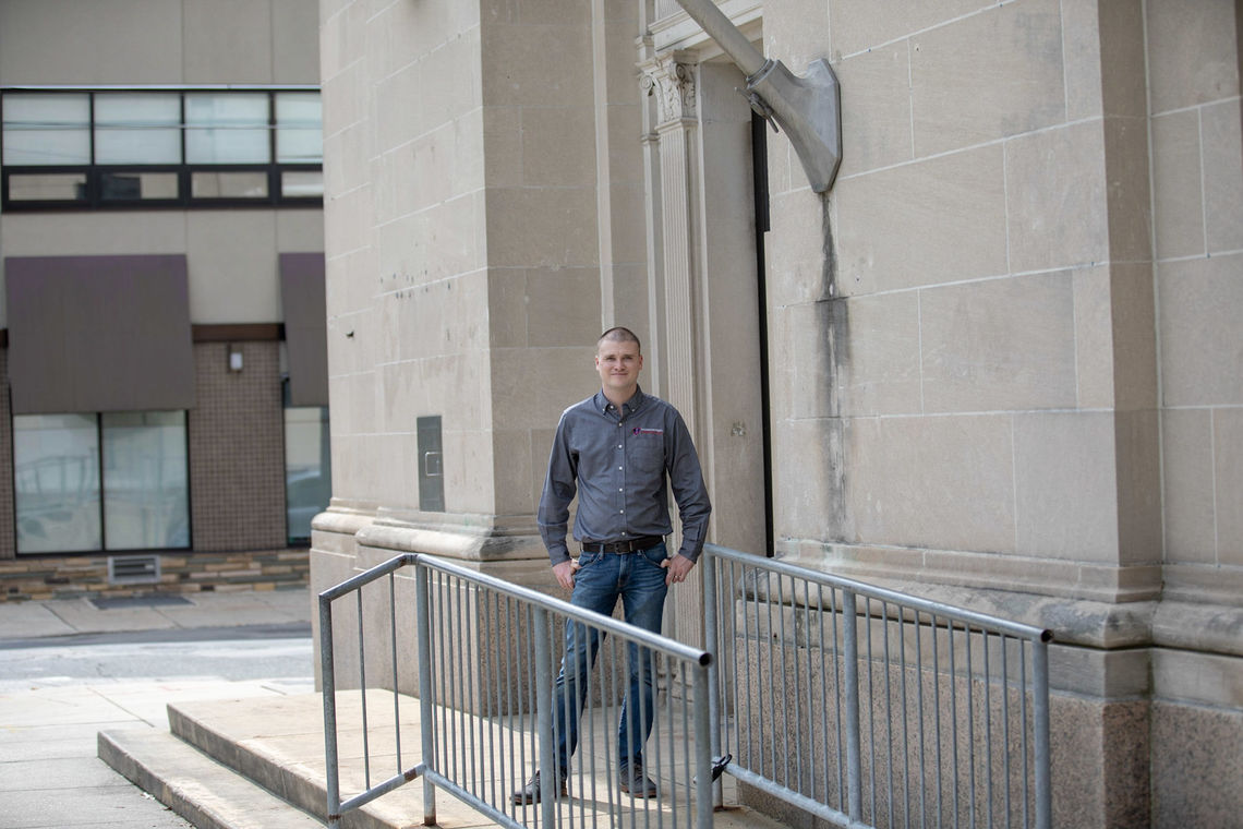 Photo: Vaughan Buckley President and Founder of Vaughan Buckley Construction outside the  former Roxborough Trust Company building