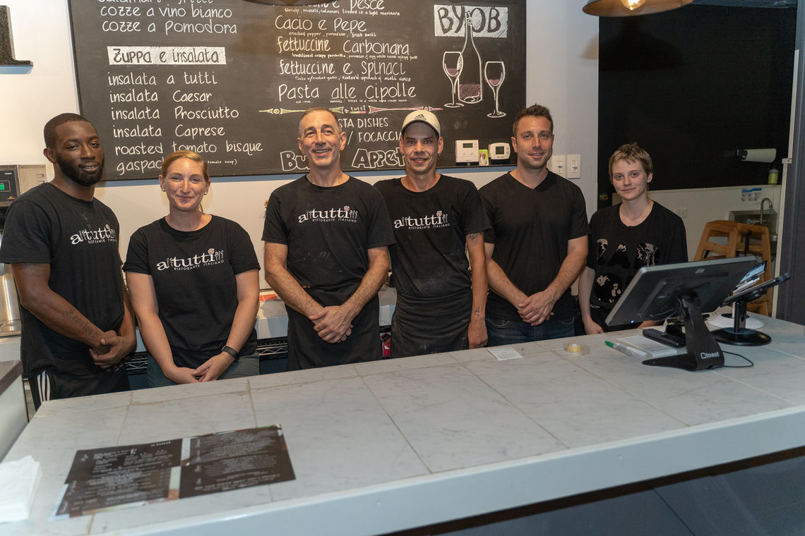 Photo: Paul Marrone (pictured third from left) owner and operator of A Tutti Restaurant joined by his staff