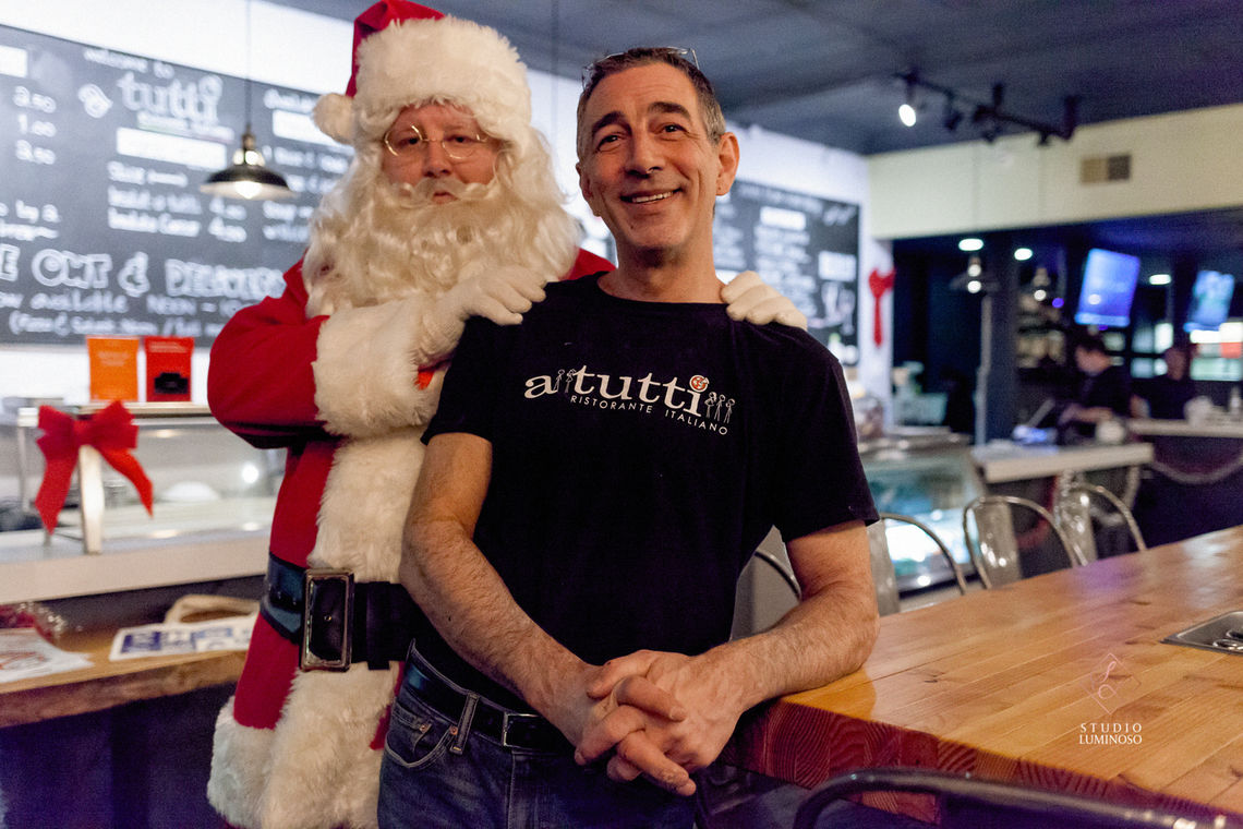 Photo: Santa stops in to visit Paul Marrone owner-opeartor of the recently opened A Tutti restaurant at 5154 Ridge Avenue as part of the Happy Holidays From Roxborough series