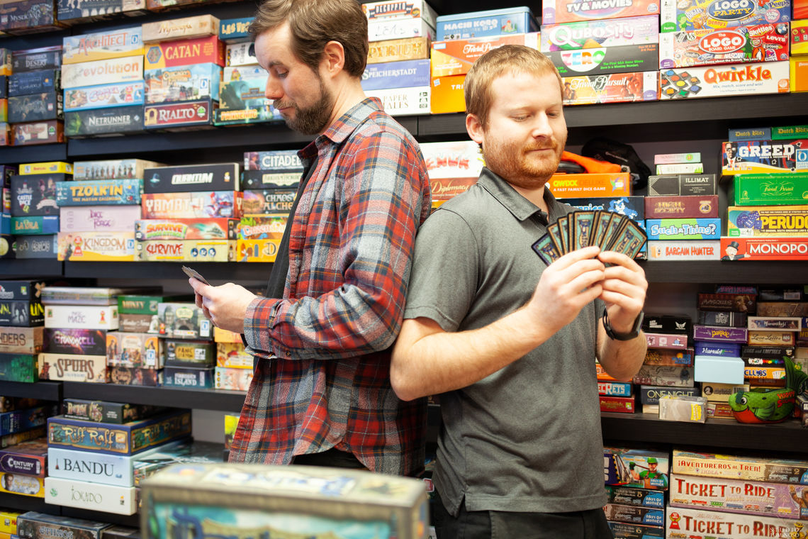Photo: Brother's Kevin Stufflet (left) and David Stufflet (right) pictured in front of the cafe's game collection, 6109 Ridge Avenue