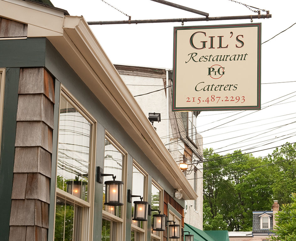 Photo: a ptg caterers sign adorns gil s storefront at 6813 ridge avenue in roxborough
