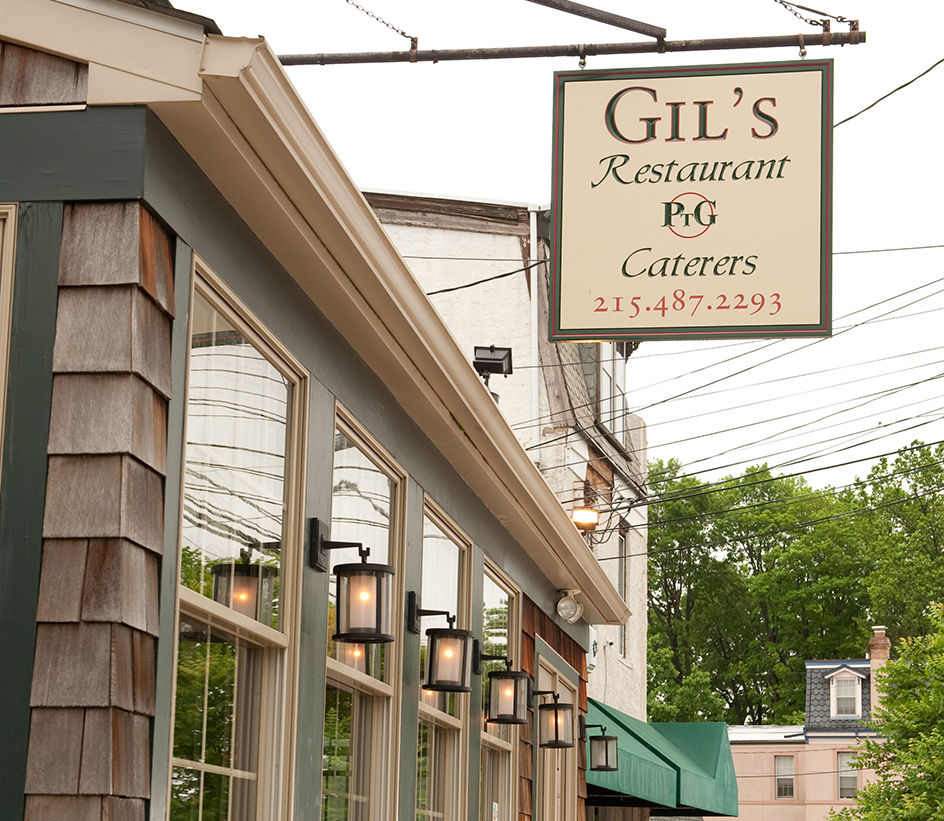Photo: A PTG Caterers Sign adorns Gil's storefront at 6813 Ridge Avenue in Roxborough
