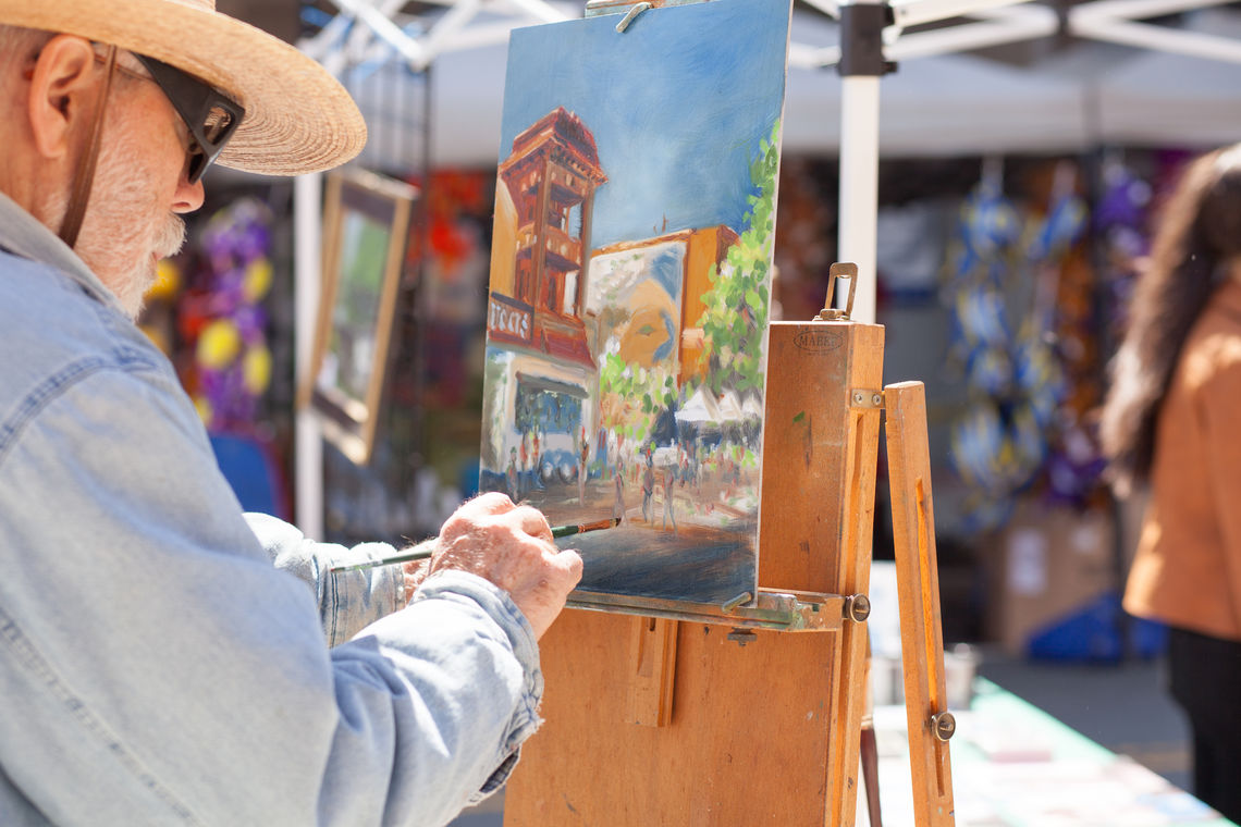 Photo: Portrait artist Harold Grote of the Manayunk-Roxborough Art Center captures a scene during the annual Art Is Life street festival