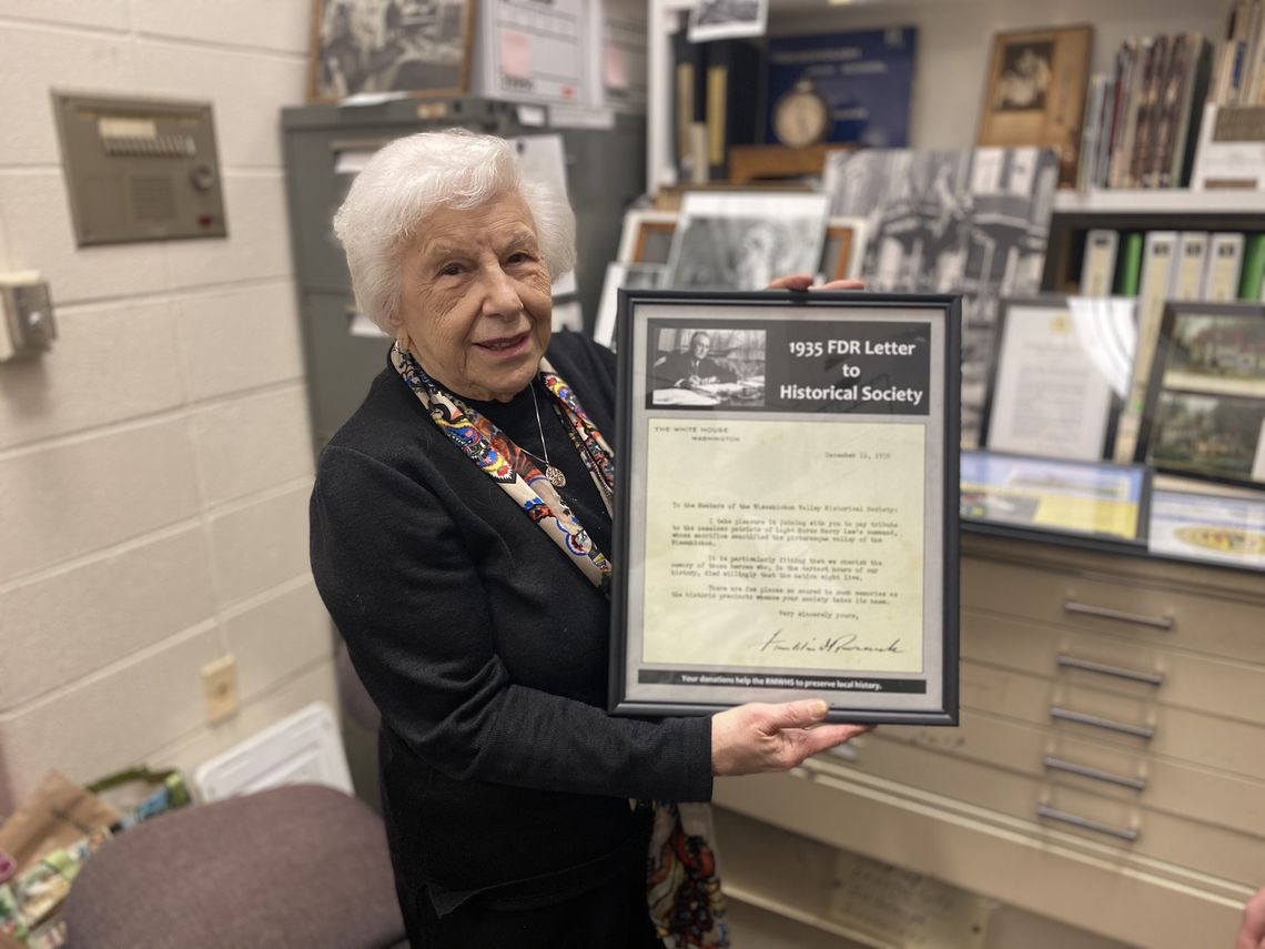 Photo: Sylvia Meyers, volunteer at Roxborough-Manayunk-Wissahickon Historical Society, holds a letter to the society from the 32nd U.S. President Franklin Delano Roosevelt